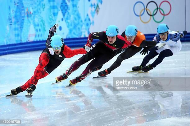 Charles Hamelin of Canada Robert Seifert of Germany Sjinkie Knegt of the Netherlands and Semen Elistratov of Russia compete in the Short rack Men's...
