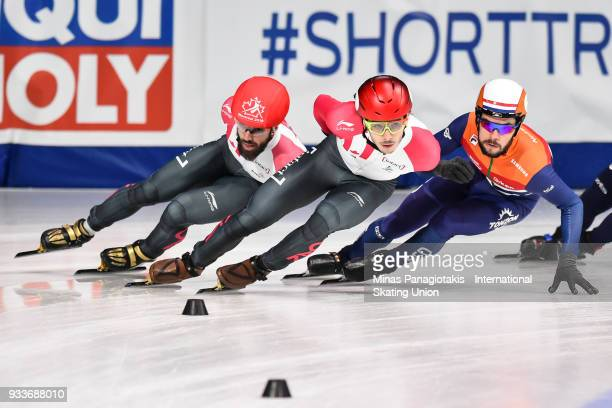 Charles Hamelin of Canada Samuel Girard of Canada and Sjinkie Knegt of the Netherlands compete in the men's 1000 meter quarterfinals during the World...