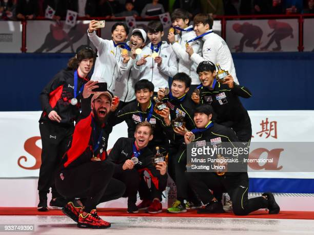 Charles Hamelin of Canada takes a selfie photo with members of Team Canada Team Korea and Team Japan during the World Short Track Speed Skating...