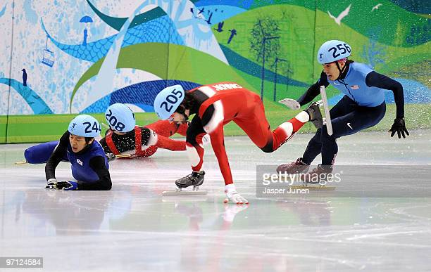 Charles Hamelin of Canada takes the lead as FrancoisLouis Tremblay of Canada and Sung SiBak of South Korea crash watched by Apolo Anton Ohno of the...