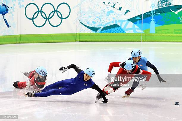 Charles Hamelin of Canada takes the lead as FrancoisLouis Tremblay of Canada and Sung SiBak of South Korea crash in the Men's 500m Short Track Speed...