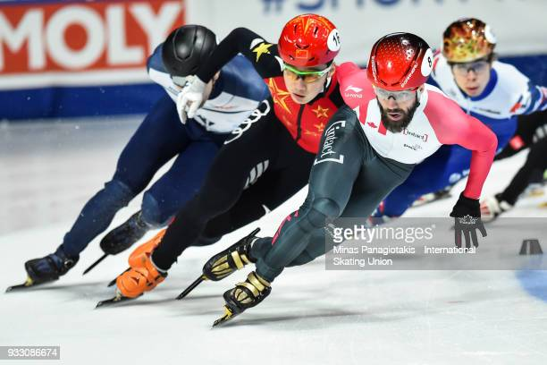 Charles Hamelin of Canada takes the lead as he competes in the men's 1500 meter semifinals during the World Short Track Speed Skating Championships...