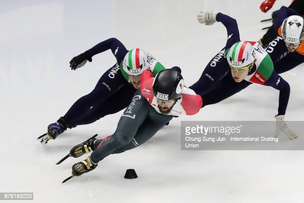 Charles Hamelin of Canada Tommaso Dotti of Italy and Yuri Confortola of Italy compete in the Men 1000m Quarterfinals during during the Audi ISU World...