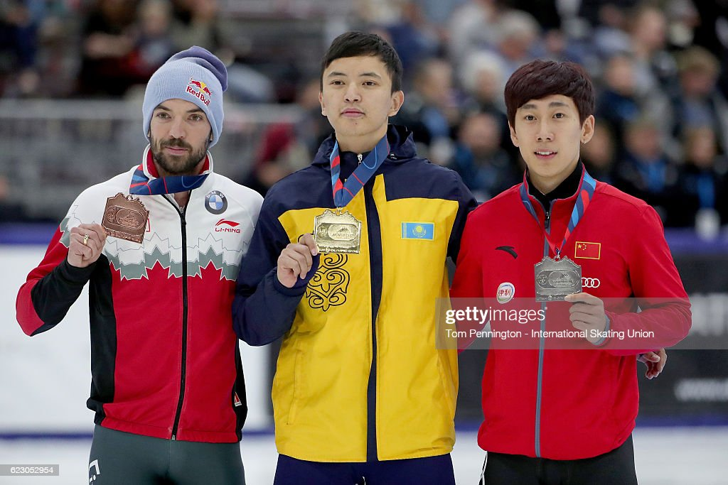 Charles Hamelin of Canada with the bronze, Abzal Azhgaliyev of Kazakhstan with the gold and Tianyu Han of China wit the silver pose in the Men's 500 meter Final during the ISU World Cup Short Track Speed Skating event on November 13, 2016 in Salt Lake City, Utah.
