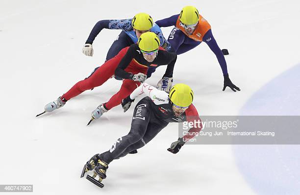 Charles Hamelin of Canada Wu Daijing of China Dmitry Migunov of Russia and Daan Breeuwsma of Netherlands compete in the Men 500M Quarterfinals during...