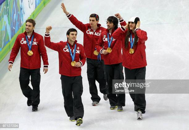 Charles Hamelin Olivier Jean Francois Hamelin FrancoisLouis Tremblay and Guillaume Bastille of Canada celebrate the gold medal after the Men's 5000m...