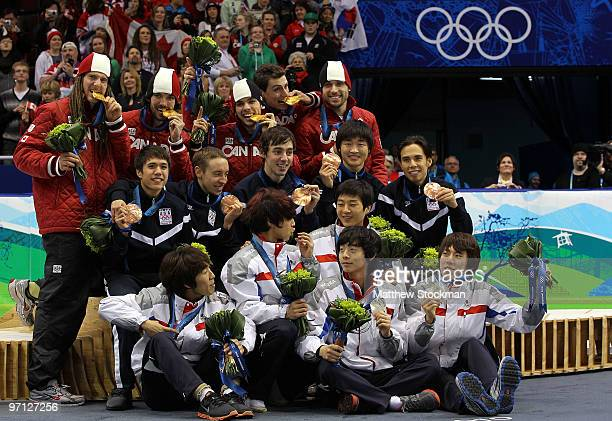Charles Hamelin Olivier Jean Francois Hamelin FrancoisLouis Tremblay and Guillaume Bastille of Canada celebrate the gold medal with silver medalists...