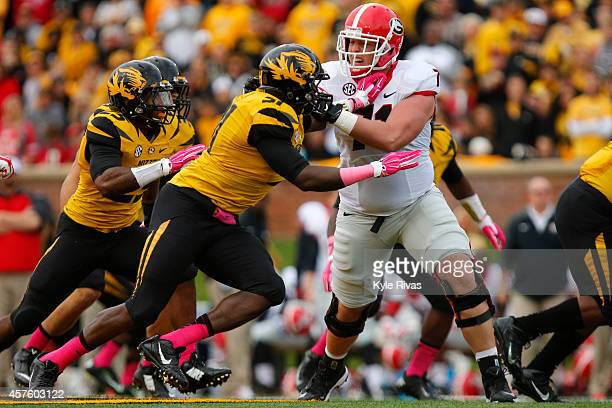 Charles Harris of the Missouri Tigers attempts to maneuver around John Theus of the Georgia Bulldogs on October 11 2014 at Faurot Field/Memorial...