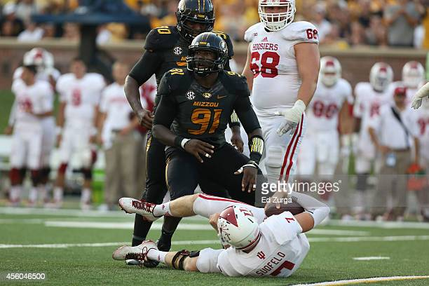 Charles Harris of the Missouri Tigers celebrates a sack quarterback Nate Sudfeld of the Indiana Hoosiers at Memorial Stadium on September 20 2014 in...