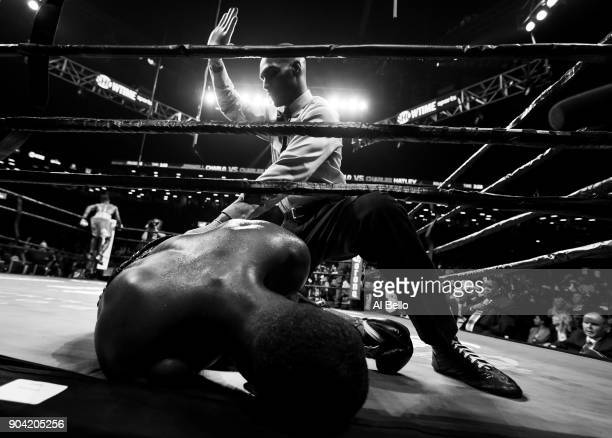 Charles Hatley is knocked out in the sixth round by Jermell Charlo during their WBC junior middleweight title bout at the Barclays Center on April 22...
