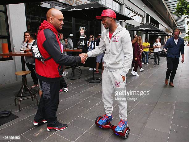 Charles Hatley of the USA shjakes a boxing fans hand as he leaves on a Segway after the weigh in ahead of tomorrow night's fight against Anthony...