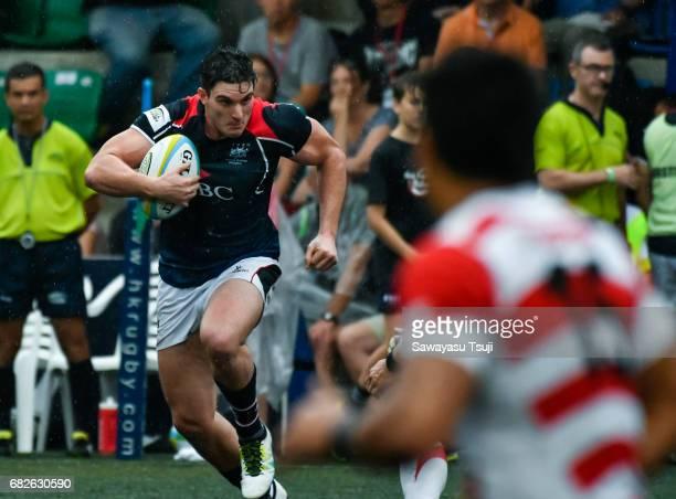 Charles HigsonSmith of Hong Kong runs with the ball during the Asia Rugby Championship 2017 match between Hong Kong and Japan on May 13 2017 in Hong...