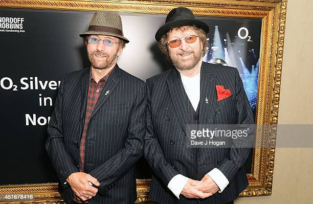 Charles Hodges and David Peacock of Chas 'n' Dave attend the Nordoff Robbins 02 Silver Clef awards at London Hilton on July 4 2014 in London England