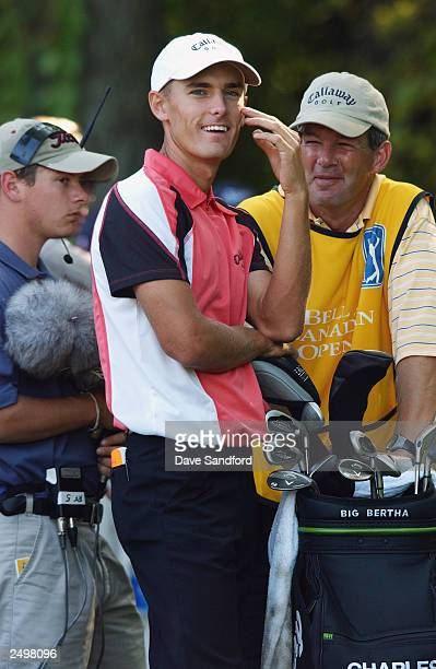 Charles Howell III has a laugh with his caddie during the Bell Canadian Open at the Hamilton Golf and Country Club in Hamilton, Ontario, Canada.