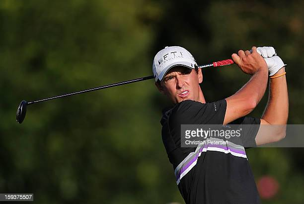 Charles Howell III hits a tee shot on the 16th hole during the third round of the Sony Open in Hawaii at Waialae Country Club on January 12 2013 in...