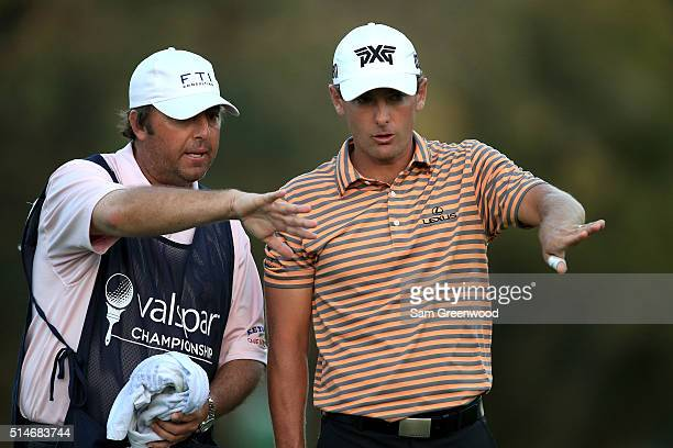 Charles Howell III lines up a putt with his caddie on the 18th green during the first round of the Valspar Championship at Innisbrook Resort...