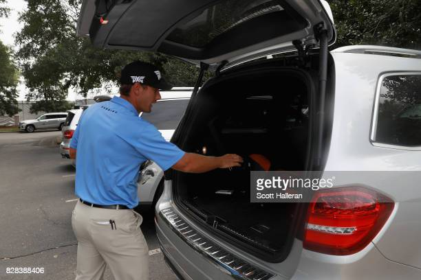 Charles Howell III of the United States prepares to ride in a courtesy car during a practice round prior to the 2017 PGA Championship at Quail Hollow...