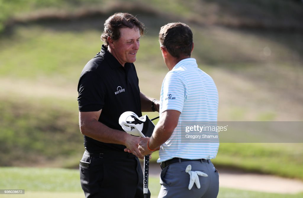 Charles Howell III of the United States shakes hands with Phil Mickelson of the United States after defeating him 3&2 on the 16th green during the first round of the World Golf Championships-Dell Match Play at Austin Country Club on March 21, 2018 in Austin, Texas.