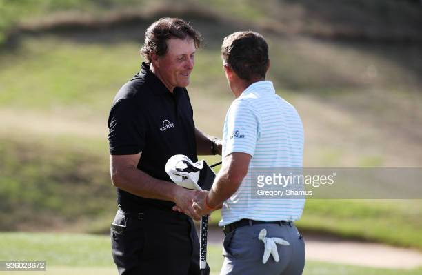 Charles Howell III of the United States shakes hands with Phil Mickelson of the United States after defeating him 32 on the 16th green during the...