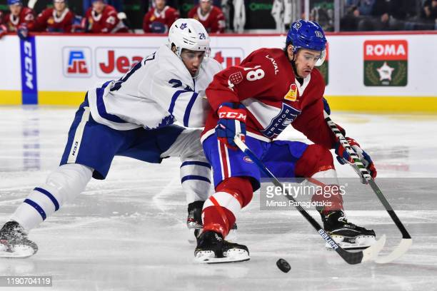 Charles Hudon of the Laval Rocket skates the puck against Jordan Schmaltz of the Toronto Marlies during the second period at Place Bell on December...