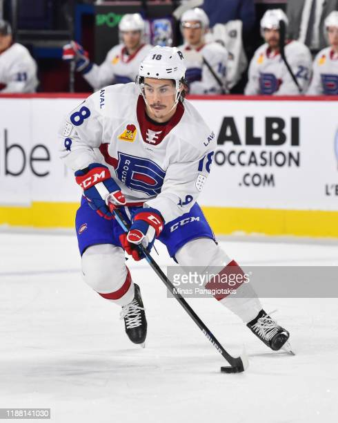Charles Hudon of the Laval Rocket skates the puck against the Milwaukee Admirals during the first period at Place Bell on November 15 2019 in Laval...