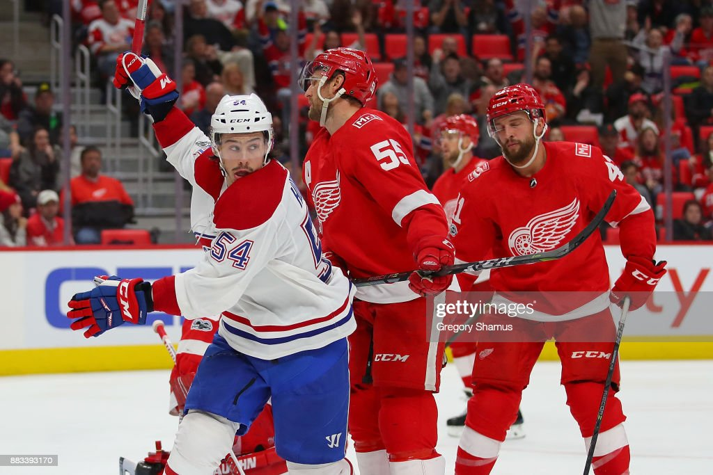 Charles Hudon #54 of the Montreal Canadiens celebrates a third period goal by teammate Brendan Gallagher #11 net to Niklas Kronwall #55 of the Detroit Red Wings at Little Caesars Arena on November 30, 2017 in Detroit, Michigan. Montreal won the game 6-3.