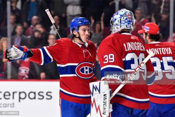 Charles Hudon of the Montreal Canadiens congratulates teammate Charlie Lindgren for their victory against the Vegas Golden Knights during the NHL...