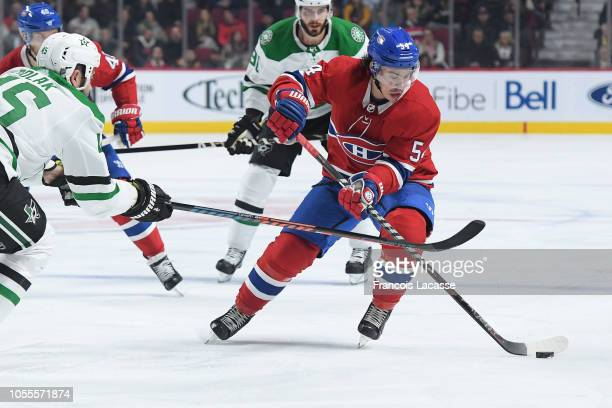 Charles Hudon of the Montreal Canadiens controls the puck while being challenged by Roman Polak of the Dallas Stars in the NHL game at the Bell...