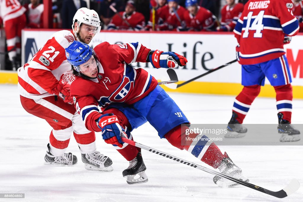 Charles Hudon #54 of the Montreal Canadiens skates against Tomas Tatar #21 of the Detroit Red Wings during the NHL game at the Bell Centre on December 2, 2017 in Montreal, Quebec, Canada. The Montreal Canadiens defeated the Detroit Red Wings 10-1.