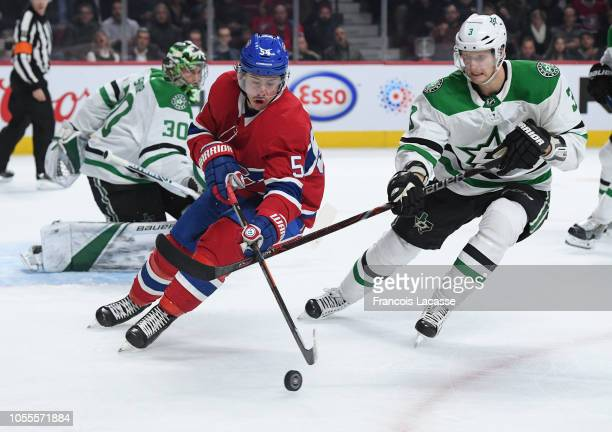 Charles Hudon of the Montreal Canadiens skates for the puck against John Klingberg of the Dallas Stars in the NHL game at the Bell Centre on October...