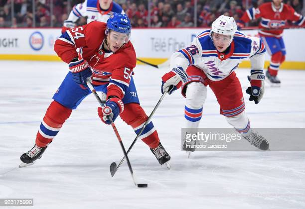 Charles Hudon of the Montreal Canadiens tries to keep the puck from Jimmy Vesey of the New York Rangers in the NHL game at the Bell Centre on...