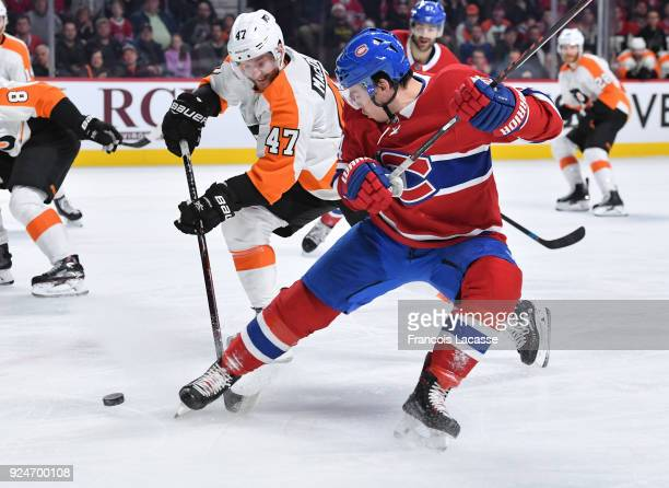 Charles Hudon of the Montreal Canadiens tries to keep the puck from Andrew MacDonald of the Philadelphia Flyers in the NHL game at the Bell Centre on...