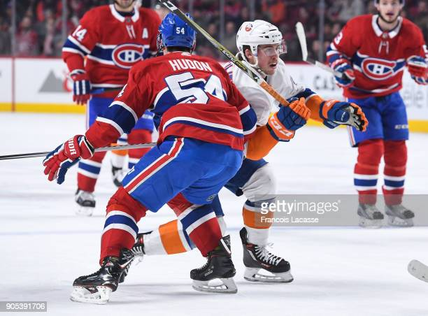 Charles Hudon of the Montreal Canadiens tries to slow down Anthony Beauvillier of the New York Islanders in the NHL game at the Bell Centre on...