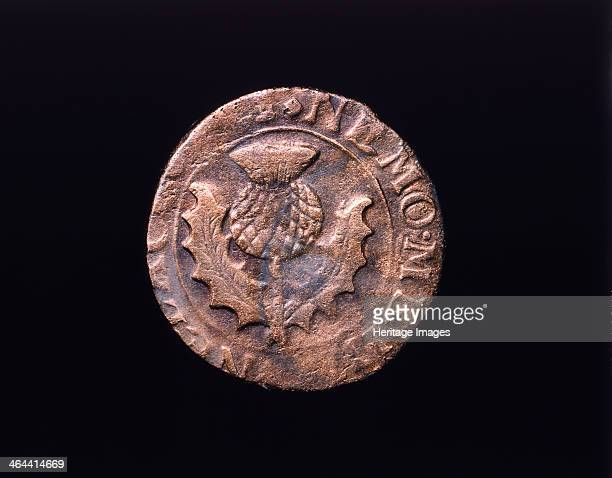 Charles I or II coin Lindisfarne Priory Northumberland 17th century The coin contains the sign of the Scottish thistle
