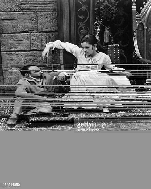 Charles Jarrott talks with Geneviève Bujold in between takes from the film 'Anne Of The Thousand Days' 1969