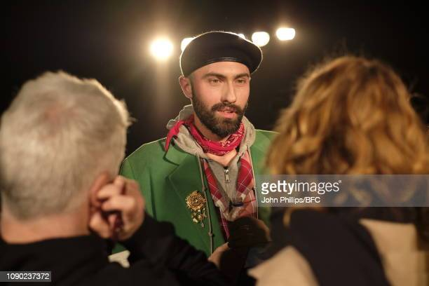 Charles Jeffrey being interviewed after the Charles Jeffrey Loverboy show during London Fashion Week Men's January 2019 at the Wapping Hydraulic...