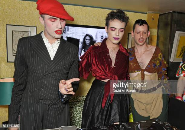 Charles Jeffrey Harry Charlesworth and Scotty Sussman attend the Love x Chaos x Poppy Delevingne x Moet Christmas Party at George on December 12 2017...