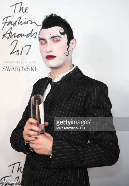 Charles Jeffrey poses in the winners room with the Menwear award for British Emerging Talent during The Fashion Awards 2017 in partnership with...