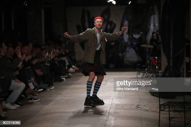 Charles Jeffrey walks the runway at the Charles Jeffrey LOVERBOY show during London Fashion Week Men's January 2018 at Old Selfridges Hotel on...
