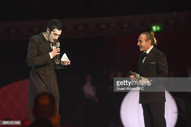 Charles Jeffrey winner of the British Emerging Talent Menswear award and John Galliano on stage during The Fashion Awards 2017 in partnership with...