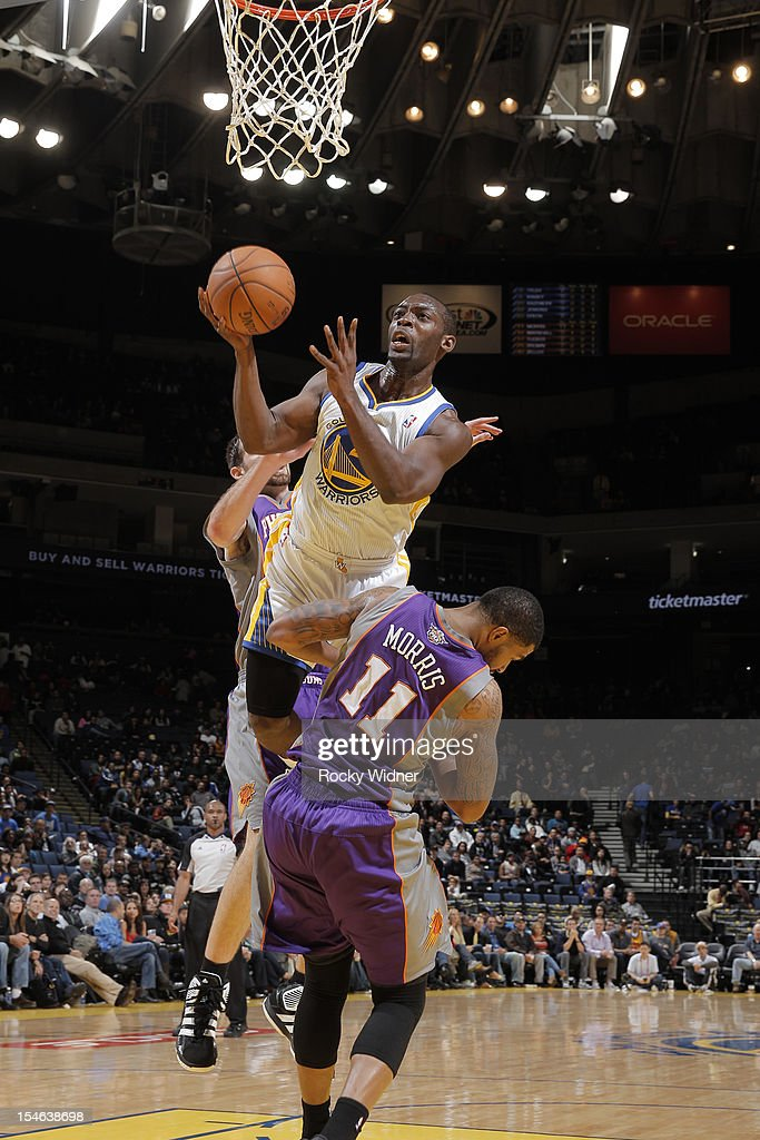 Charles Jenkins #22 of the Golden State Warriors attempts a shot against Markieff Morris #11 of the Phoenix Suns during a pre-season game on October 23, 2012 at Oracle Arena in Oakland, California.