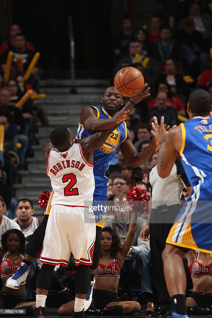 Charles Jenkins #22 of the Golden State Warriors passes against Nate Robinson #2 of the Chicago Bulls on January 25, 2012 at the United Center in Chicago, Illinois.