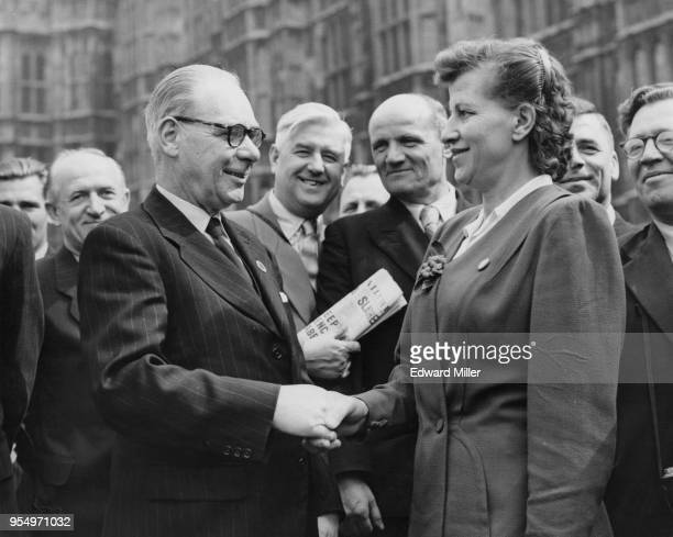 Charles 'Jim' Simmons the Labour MP for Brierley Hill welcomes Andreevna Fedina to London outside the Houses of Parliament 15th May 1956 A trolleybus...