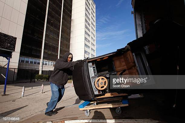 Charles Johnson helps a resident move from 1230 N Burling St the last occupied highrise in the CabriniGreen public housing complex on December 2 2010...