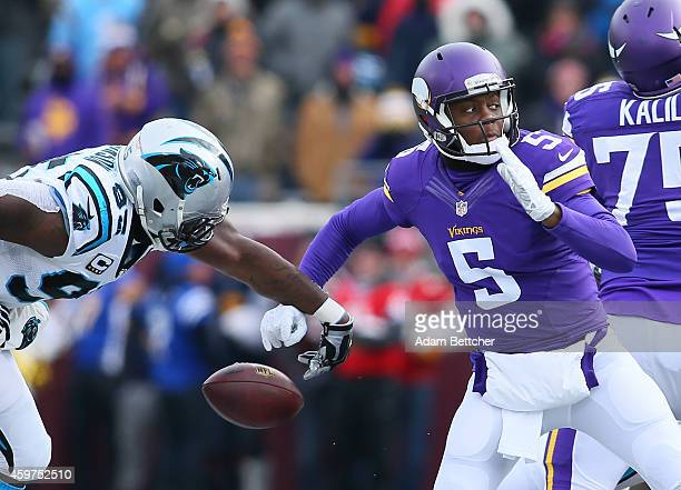 Charles Johnson of the Carolina Panthers gets his hand on the ball forcing a fumble that Teddy Bridgewater of the Minnesota Vikings recovered in the...