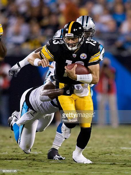 Charles Johnson of the Carolina Panthers runs down Mike Reilly of the Pittsburgh Steelers during their preseason game at Bank of America Stadium on...