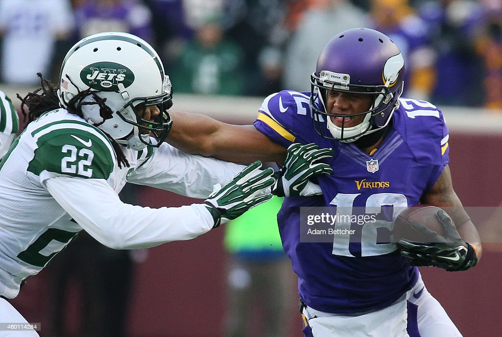 Charles Johnson #12 of the Minnesota Vikings stiff arms Marcus Williams #22 of the New York Jets in the fourth quarter on December 7, 2014 at TCF Bank Stadium in Minneapolis, Minnesota.