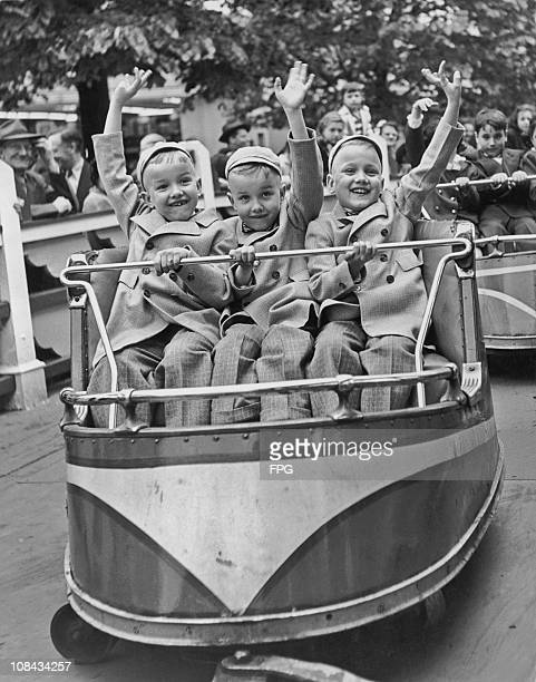 Charles Joseph and Mike Mauer riding the Whip at the Palisades Amusement Park during the National Triplets Convention held in Palisades Park New...
