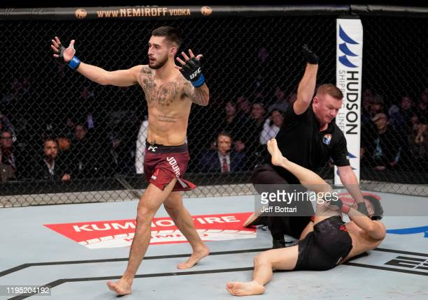 Charles Jourdain of Canada celebrates after knocking out Dooho Choi of South Korea in their featherweight fight during the UFC Fight Night event at...