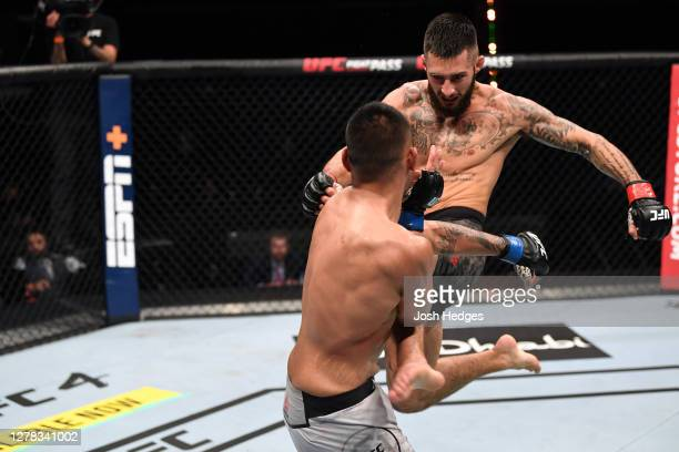 Charles Jourdain of Canada kicks Josh Culibao of Australia in their featherweight bout during the UFC Fight Night event inside Flash Forum on UFC...
